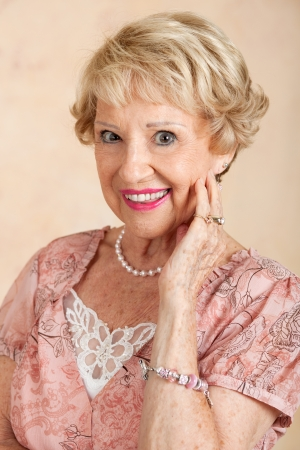 Portrait of a beautiful blond senior woman.   photo