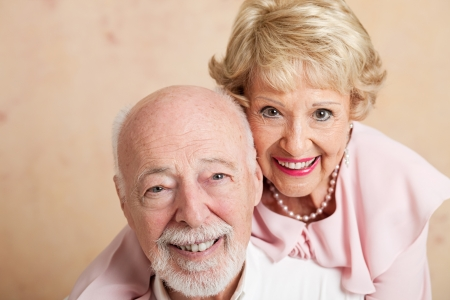 Closeup of good looking senior couple.  Shallow depth of field with focus on husband in foreground. Stock Photo - 14778801