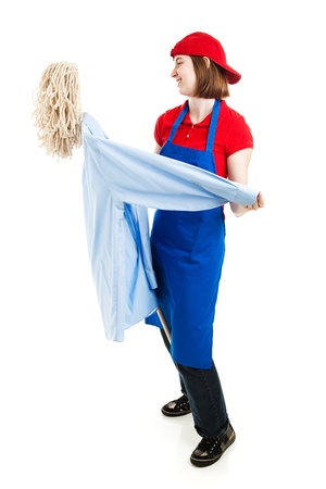 goofing: Teenage worker dancing with a mop, pretending its a person. Full body isolated on white.