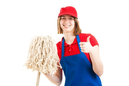 first job: Teenage girl in a work uniform, holding a mop and giving the thumbs up sign.  Isolated on white.