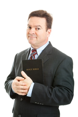 serious guy: Businessman holding the Bible.  Isolated on white.   Stock Photo