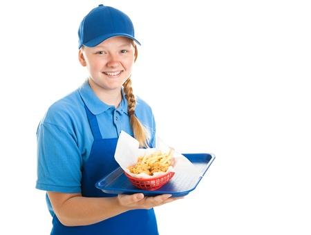 Teenage fast food worker holding a tray of chicken nuggets and fries.  Isolated on white. photo