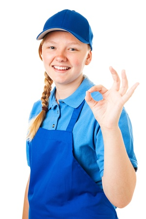 first job: Teenage girl with her first job, giving the okay sign.  Isolated on white.