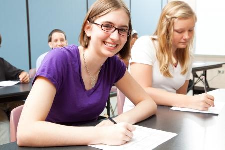Teenage girls in high school class.  Real people.   photo