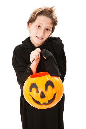 Cute little boy trick or treating on Halloween.  Isolated on white.