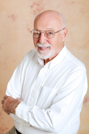 bifocals: Portrait of a handsome, intelligent senior man in a business shirt and glasses.   Stock Photo
