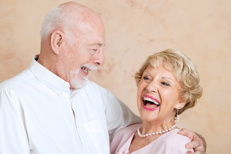 deafness: Senior couple in love, still make each other laugh.