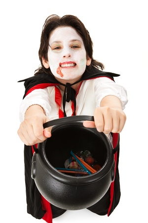 Child dressed as a vampire for Halloween, trick or treating for candy.  Isolated on white.   photo