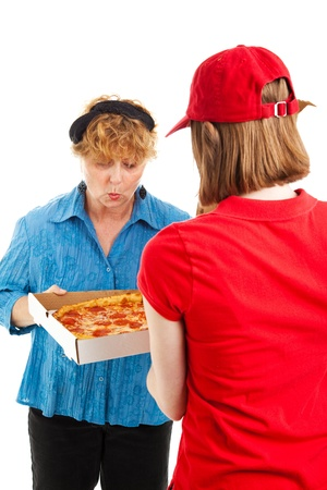 Happy woman inspects the pizza shes having delivered by a delivery girl.   photo