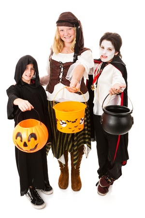 Three children of various ages dressed for Halloween.  Full body isolated on white.   photo