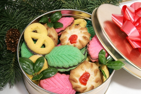 Closeup of a tin of cookies under the Christmas tree.   Stock Photo - 16246664