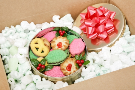 send mail: A tin of Christmas cookies being shipped by mail.