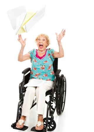 Senior woman screaming in frustration over her medical bills.  Full body isolated on white.   photo