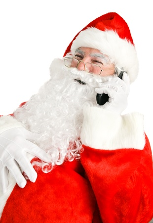 Portrait of Santa Claus having a telephone conversation and laughing out loud.  White background.   photo