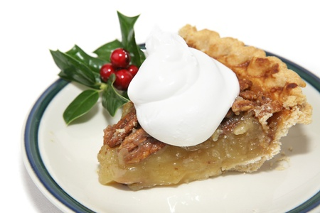 Slice of pecan pie with whipped cream and Christmas holly garnish.   Stock Photo - 16246668