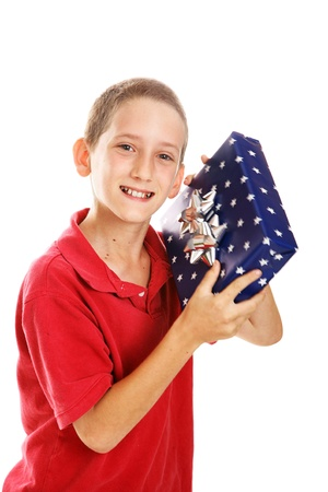 Little boy shaking a gift.  Wrapping could be for Hanukkah or Christmas.  Motion blur on package.  Isolated. photo