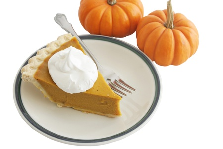cream pie: Pumpkin pie slice with mini pumpkins, isolated on white