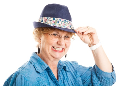 tipping: Head and shoulders portrait of a cute middle aged woman tipping her fedora hat.  Isolated on white.   Stock Photo