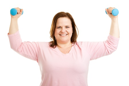 Beautiful, healthy plus-size woman working out with hand weights.  Isolated on white.   photo