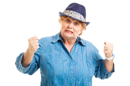 gritting: Attractive middle-aged woman showing frustration.  Isolated on white.