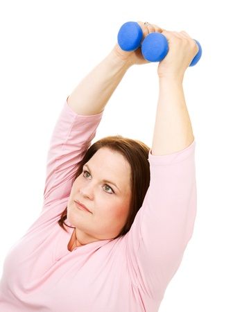 Pretty, plus size woman working out with hand weights.  Isolated on white.   photo