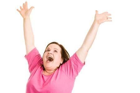 extase: Pretty plus sized vrouw verhogen haar armen in extase. Geïsoleerd op wit. Stockfoto