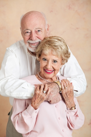 Beautiful senior couple in love, posing for a portrait in a close embrace.   photo