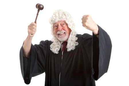 judges: British judge in white wig, waving his gavel around in frustration and anger.  Isolated on white.