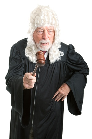 Firm, angry British style judge with white wig, waving his gavel.  Isolated on white.   photo