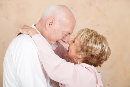 Senior couple still in love and happy after decades of marriage.   photo