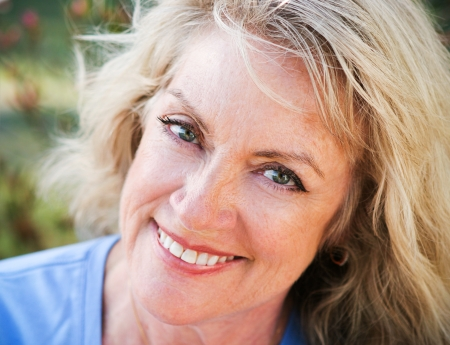 50: Beautiful middle-age blond woman, closeup portrait smiling and happy