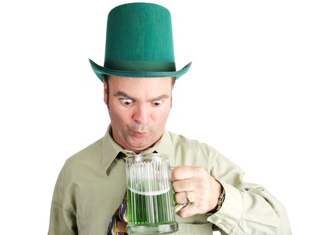 Drunk Irish-American man looks into his green beer on St  Patrick photo
