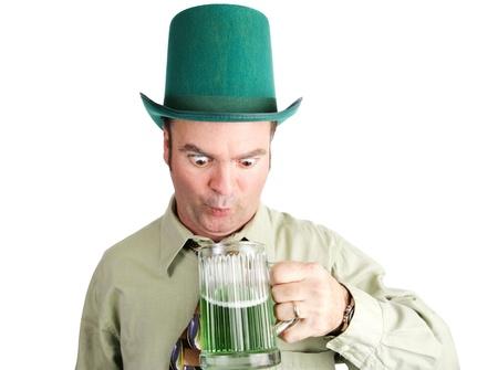 irish ethnicity: Drunk Irish-American man looks into his green beer on St  Patrick