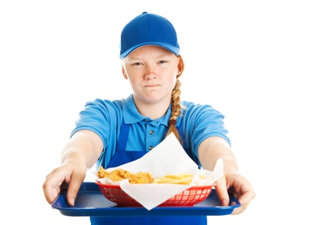 Teen girl serving fast food along with a big helping of bad attitude   Isolated on white