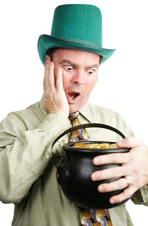 Irish man dressed as leprechaun, excited to be getting a pot of gold coins   White background    photo