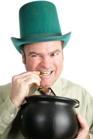 irish ethnicity: Irish man dressed as a leprechaun for St  Patrick Stock Photo