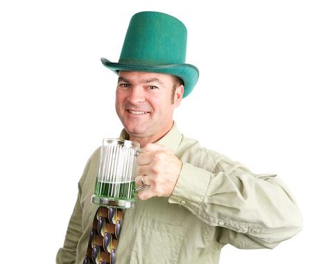 Irish man drinks green beer to celebrate St  Patrick photo