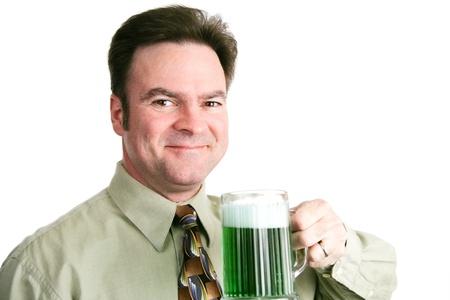 irish ethnicity: Handsome Irish American man celebrating St Patricks day with a mug of green beer   Portait over white