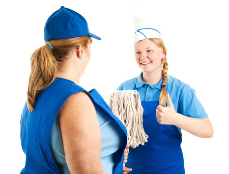 Teenage worker gives the thumbs up sign as her boss hands her the mop   Isolated on white    photo