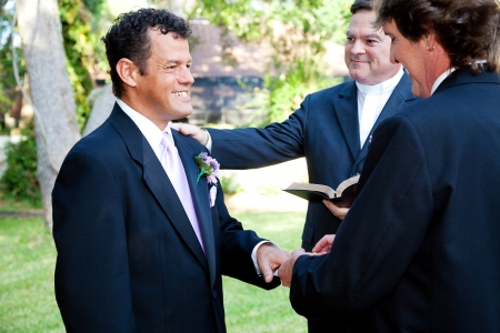 gay couple: Gay couple exchanges rings during their wedding ceremony