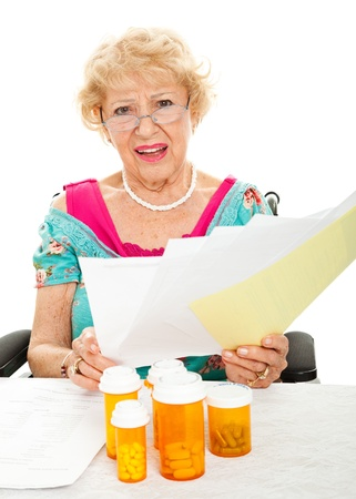 medical bill: Disabled senior woman frustrated by the cost of prescription drugs and other medical expenses   White background