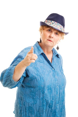 Middle aged woman pointing her finger in a bossy, scolding gesture   Isolated on white    photo