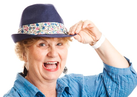 tipping: Close up portrait of a middle-aged woman happy, smiling, and laughing while tipping her hat   Isolated on white