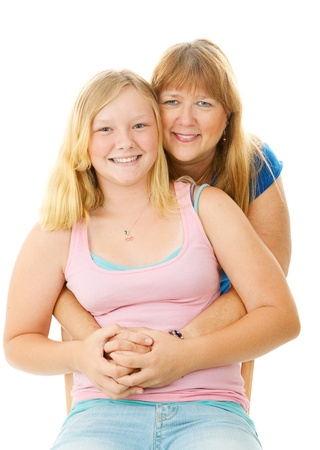 Portrait of a beautiful blond, blue eyed mother and teenage daughter.  Isolated on white.