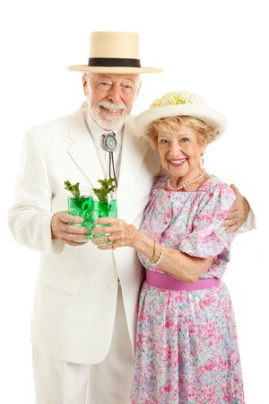 kentucky derby: Kentucky Colonel and his wife dressed up and drinking mint juleps in celebration of Kentucky Derby Day.  Isolated on white.