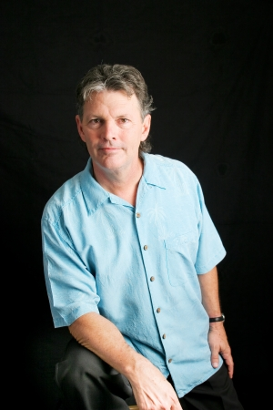 50s adult: Portrait of a handsome man in his mid fifties posing in front of a black background.