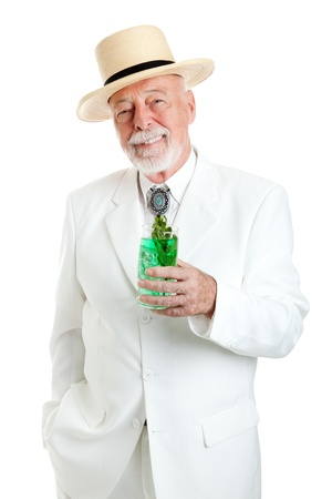 colonel: Handsome Kentucky colonel or Southern gentleman drinking a mint julep for Derby Day.  Isolated on white.