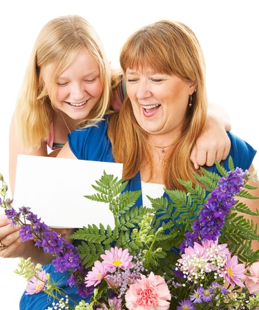 Teenage daughter giving flowers and a card to her mother on Mother's Day.  Card blank ready for your text.