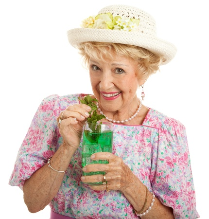 belle: Sweet Southern lady drinking a mint julep for the Kentucky Derby.  Isolated on white.