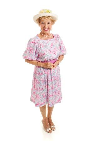 Mooie dame senior uit de Zuidelijke VS, gekleed in een feest jurk en hoed. Volledige lichaam geïsoleerd op wit. Stockfoto - 18904521